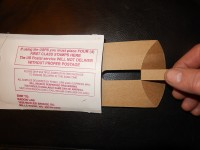 Remove cardboard insert from radon test kit